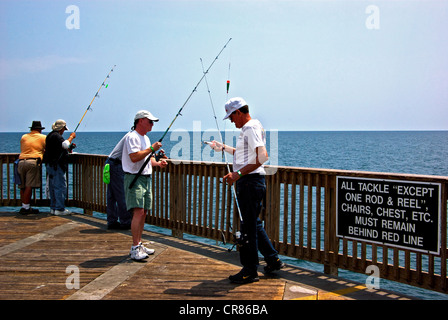 Rod reel tackle rules far offshore end Gulf Shores State Park Alabama sport fishing pier - Stock Photo