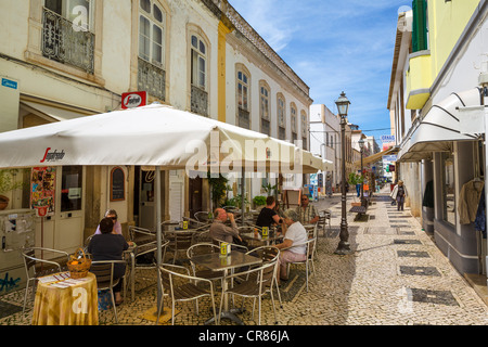 Street cafe and shops in the Old Town, Silves, Algarve, Portugal - Stock Photo