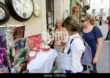 France Gard Uzes listed as town of art history Place Dampmartin shopping with friends in pedestrian streets of historic - Stock Photo