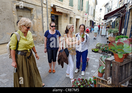 France, Gard, Uzes, listed as town of art and history, shopping with friends in the pedestrian streets of the historic - Stock Photo