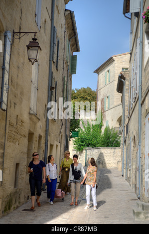 France, Gard, Uzes, listed as town of art and history, walk with friends in the maze of streets in the historic - Stock Photo