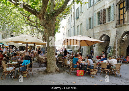 France Gard Uzes listed as town of art history weekly market in Place aux Herbes surrounded by arcaded houses outdoor - Stock Photo