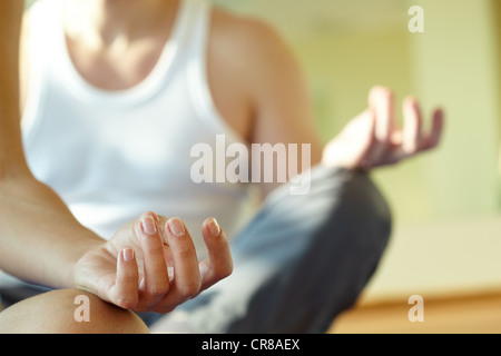 Close-up of feminine and masculine arms during meditation - Stock Photo