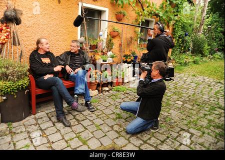 Franz Xaver Gernstl, 2nd left, director of TV series Gernstl Unterwegs, interviewing the art restorer Stephan Muehlbauer, - Stock Photo