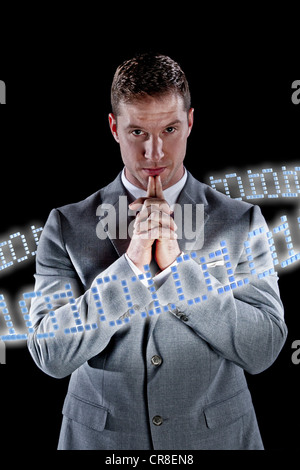 Businessman surrounded by ring of binary code - Stock Photo
