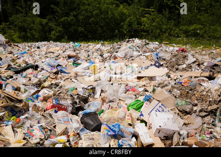 Heap of recyclable materials in sorting centre - Stock Photo