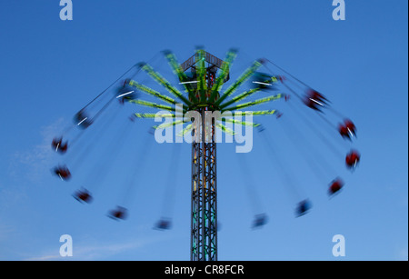 Carousel against a blue sky, blurred - Stock Photo