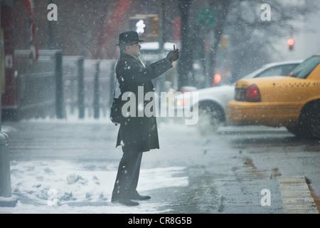 Mature man hailing cab in city - Stock Photo