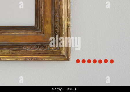Red sold dots under picture frame - Stock Photo