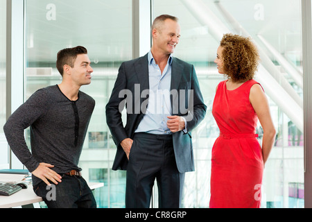 Business colleagues talking in office