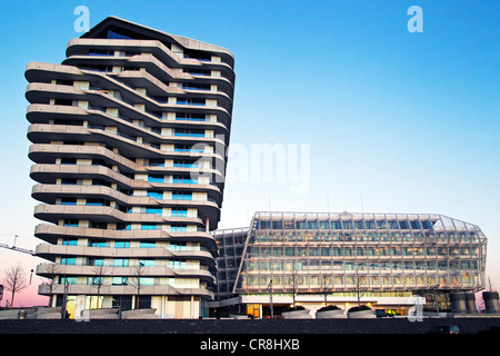 Modern architecture, Marco Polo Tower and Unilever building in HafenCity in the evening light, Port of Hamburg, - Stock Photo