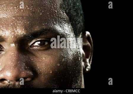 Boxer with sweaty face, close up - Stock Photo