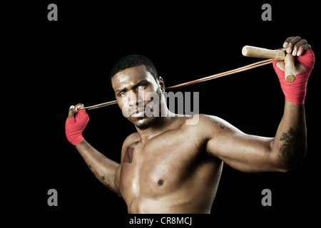 Boxer stretching with rope - Stock Photo
