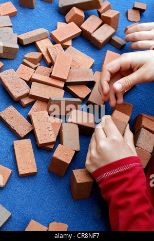 Children's hands playing with clay blocks, Flachsmarkt historical crafts market, Krefeld-Linn, North Rhine-Westphalia - Stock Photo