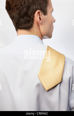 Young man with tie over shoulder