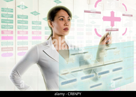Woman interacting with holographic screens - Stock Photo
