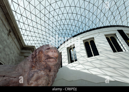 Great Court, inner courtyard with modern domed roof, steel and glass structure, and lion sculpture from Knidos, - Stock Photo