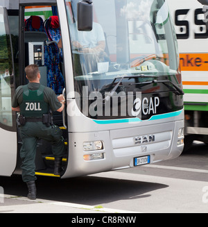 Customs officers inspecting a bus in Berlin Mitte, Germany, Europe - Stock Photo