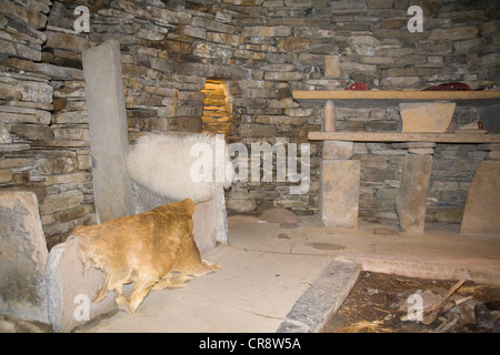 Bay of Skaill Orkney West Mainland Reconstructed stone round house at Skara Brae Neolithic village - Stock Photo