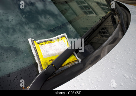 Car Parking Penalty Charge Notice on Car Windscreen - Stock Photo