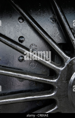 Driving wheel of steam locomotive. - Stock Photo