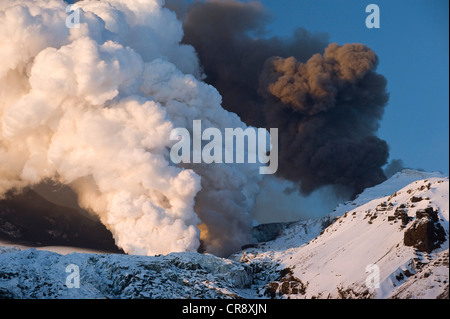 Cloud of ash from Eyjafjallajoekull volcano and a steam plume from the lava flow in Gigjoekull glacier tongue, Iceland, - Stock Photo