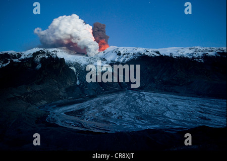 Ash cloud of the Eyjafjallajoekull volcano, steam plume from the lava flow in Gigjoekull glacier tongue, and exit - Stock Photo