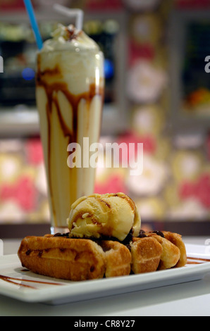 Waffle with vanilla and chocolate and ice cream sundae with whipped cream and nuts. Bar in Barcelona, Spain. - Stock Photo