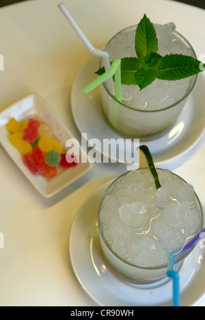 Two caipirinhas with some sweets in a bar in Barcelona, Spain. - Stock Photo