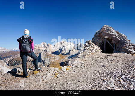 Hiker on Costabela Mountain while using the Bepi Zac climbing route in San Pellegrino Valley above San Pellegrino - Stock Photo