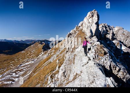 Climber on Bepi Zac climbing route in San Pellegrino Valley above San Pellegrino Pass, overlooking the Bervagabunden - Stock Photo