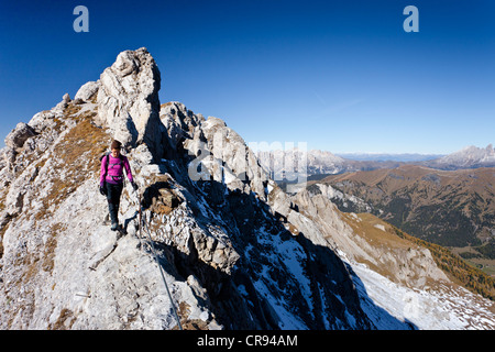 Hiker on Bepi Zac climbing route in the San Pellegrino Valley above the San Pellegrino Pass, with the Dolomites - Stock Photo
