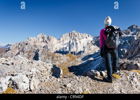 Hiker on Costabella Mountain while ascending the Bepi Zac Climbing Route in the San Pellegrino Valley above the - Stock Photo