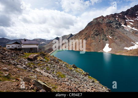 View over Green Lake with Hoechster Huette alpine hut while descending from Zufrittspitz Mountain towards the Ulten - Stock Photo