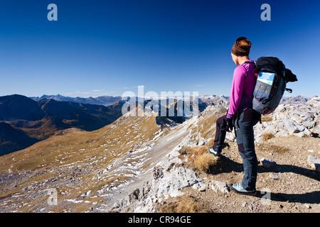 Hiker at the Bepi Zac via ferrata in the San Pellegrino valley, above the San Pellegrino pass, on Mt Cima Campagnacia - Stock Photo