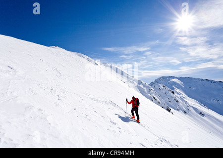 Ski mountaineers during the ascent to Mt Hoertlahner above Durnholz, Sarntal valley, Mt Jakobspitz at back, South - Stock Photo