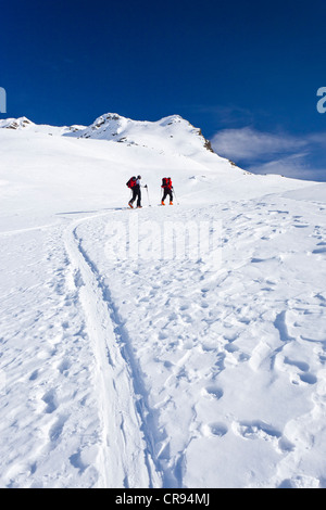 Ski mountaineers during the ascent to Mt Hoertlahner above Durnholz, Sarntal valley, South Tyrol, Italy, Europe - Stock Photo