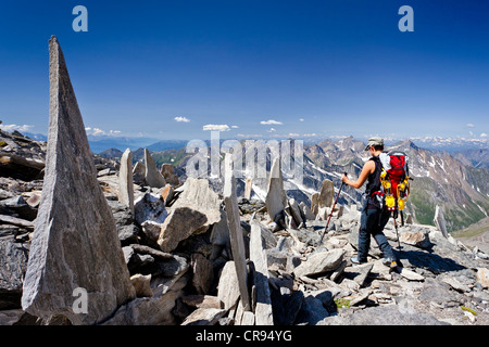 Mountaineers descending from Hochfeiler or Gran Pilastro mountain, view on Val di Vizze or Pfitschertal and Wipptal - Stock Photo