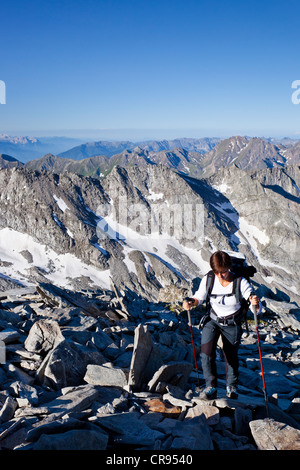 Female mountaineer climbing Hochfeiler mountain, Pfitschertal, Eisack and Wipptal valleys, and the Dolomites at - Stock Photo