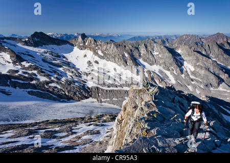 Mountaineer climbing Hochfeiler mountain, Pfitschertal valley, Eisacktal valley and Wipptal valley at the back, - Stock Photo