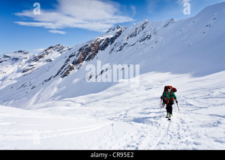 Ski mountaineers during ascent to Mt Staudenberg Joechl in Ridnaun above Schneeberg, Sterzing, South Tyrol, Italy, - Stock Photo