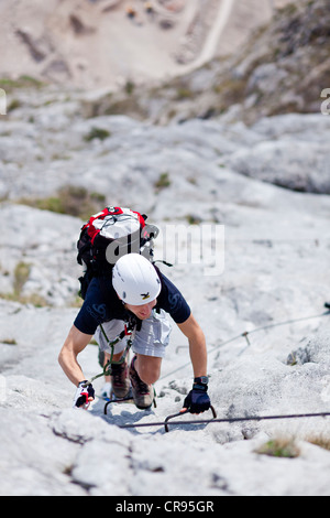 Climber on the Che Guevara fixed rope route on Mt. Monte Casale in the Sarca Valley, Lake Garda region, Trentino, - Stock Photo
