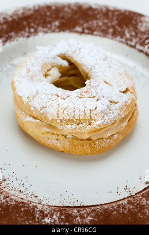 French pastries 'Paris-Brest' named after the cycling race, choux pastry with different fillings, originally with - Stock Photo