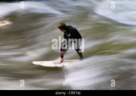 Surfer on a wave in the Eisbach, English Garden, Munich, Upper Bavaria, Bavaria, Germany, Europe - Stock Photo