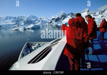 Tourists on cruise ship in Paradise Bay, Graham Land, Antarctic Peninsula, Antarctica - Stock Photo