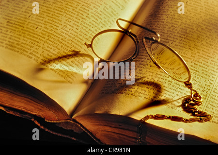 Pince-nez spectacles on an old Stowasser Latin-German dictionary - Stock Photo