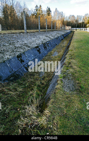 Electrified barbed wire and trenches on the camp grounds, Dachau Concentration Camp, Dachau, near Munich, Bavaria - Stock Photo