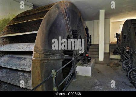 Paddle wheels, baroque pumping station in the Gruenes Brunnenhaus well house, Nymphenburg Park, Munich, Bavaria, - Stock Photo