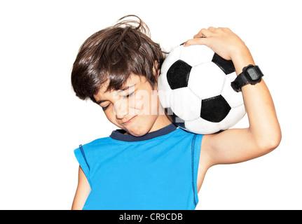 Football player celebrating victory, cute little boy playing, kid enjoying team game, teen holding catching ball, - Stock Photo