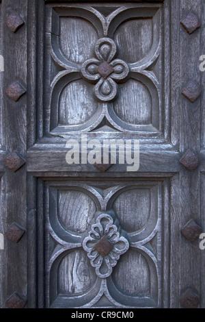 Old carved oak cathedral door detail, Lincoln Cathedral, Lincoln, Lincolnshire, England, UK - Stock Photo